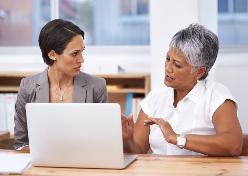 Woman Entrepreneur with Counsellor talking about Access Capital