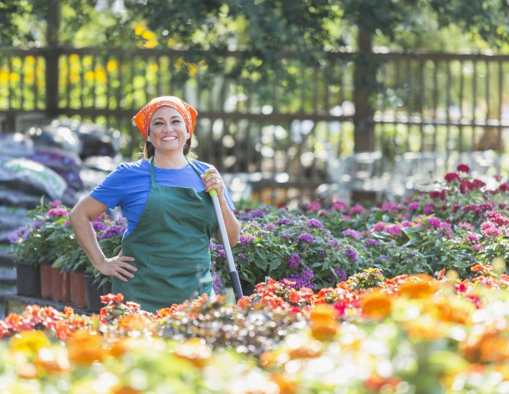 Business Woman Posing at Plant Nursery